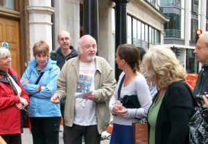 Mike Pentelow with crowd on guided walk in Fitzrovia