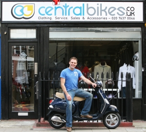 Dan Rose on scooter outside Central Bikes