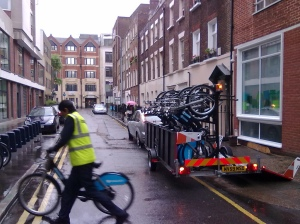 Transport for London Cycle Station being re-stocked with cycles