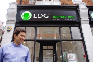 All smiles. Laurence Glynne outside his showroom in Foley Street, Fitzrovia