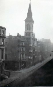 Looking south down Charlotte Street at the church of St John the Evangalist (consecrated in 1846). In the house between the church and the corner with Chitty Street lived John Constable until his death in its attic room in 1837. Picture taken during the 1930s, courtesty of Sam Lomberg.