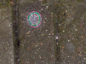 Gum Art, by artist Ben Wilson,  on pavement outside 28 Tottenham Street. The first piece on Art Intervention Trail.