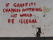"Writing on a wall says: ""If graffiti changed anything - it would be illegal"""