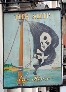 Pub sign showing skull and cross bones pirate flag.