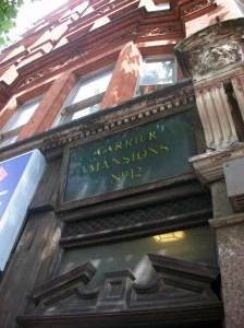 Part of front door and facade of building.