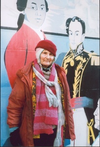 Woman standing in front of street mural.