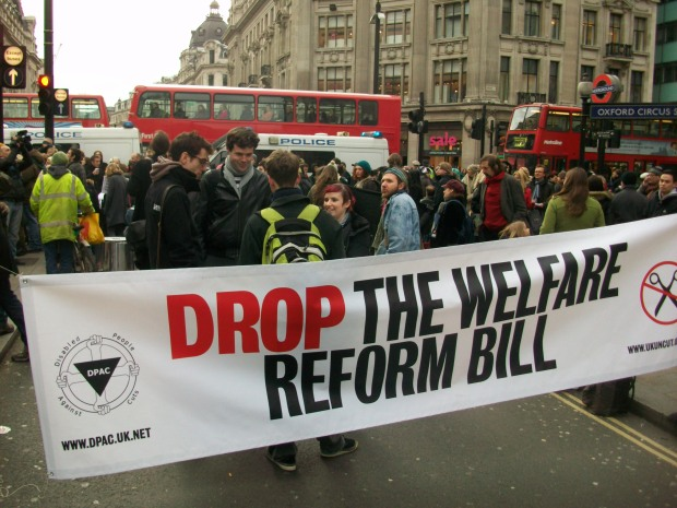 A banner says drop the welfare reform bill.