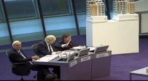 Boris Johnson sitting with colleagues at City Hall.