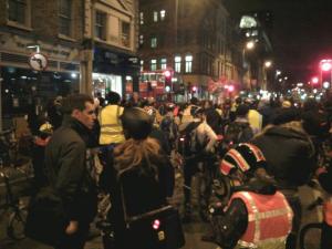 People standing in road.
