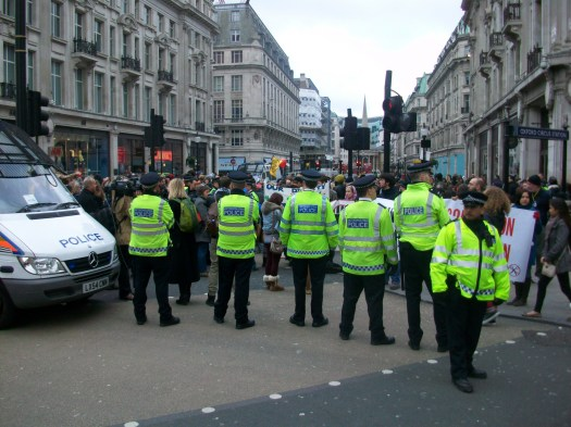 Police standing at Oxford circus.