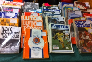 Sports programmes displayed on table.