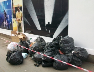 Rubbish bags in front of photograph.
