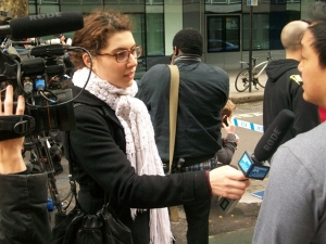 A TV reporter interviews a witness.