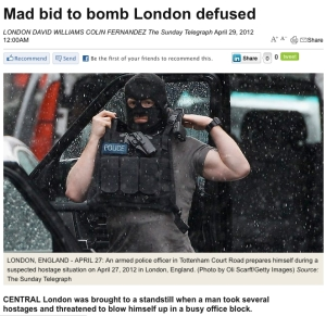 Page from Australian newspaper website with armed police in mask.