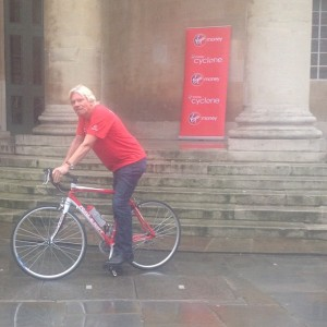 Richard Branson on Raleigh bicycle outside All Souls Church.
