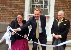 Man cutting ribbon.