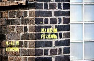 No BID in Fitzrovia in yellow stencil on wall.