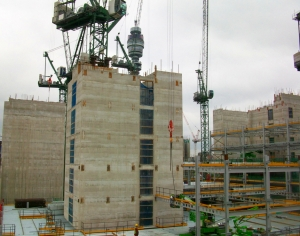 Construction workers bolt steel girders to concrete cores at Fitzroy Place.