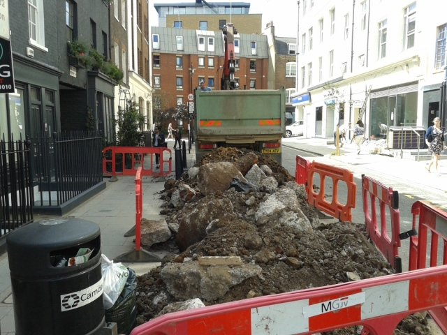 Building rubble in street.