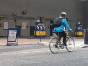 A cyclists rides passed a closed petrol station in Fitzrovia, London.