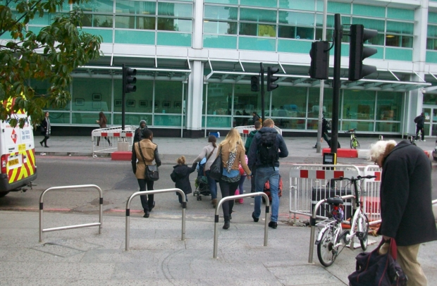 Cycle stands blocking crossing.