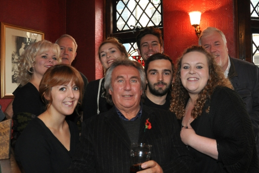 Cast and production team in pub.