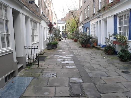 Flagstones in pedestrian street.