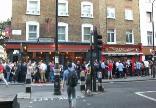 Pub with crowds of people outside.