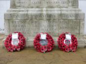 Three wreaths at memorial.