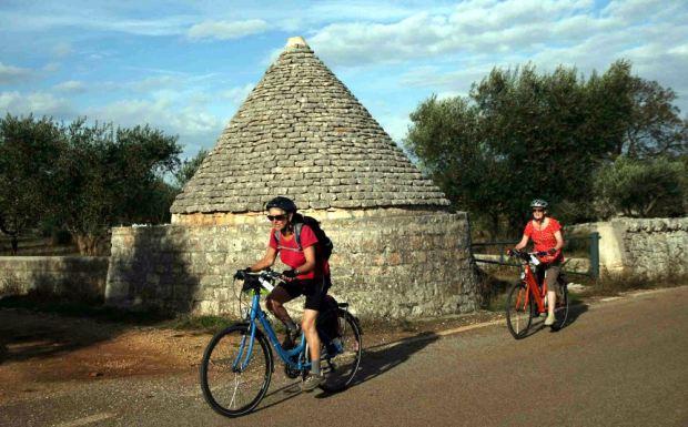 Two women cycling.