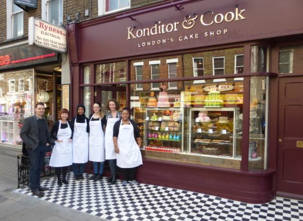 Staff standing in front of bakers.