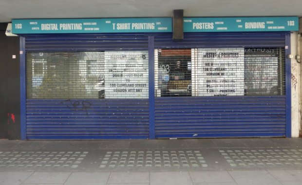 Roller shutters down on shopfront.