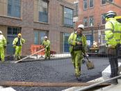 Men laying tarmac.