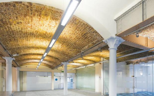 Inside of building showing brickwork and ironwork.