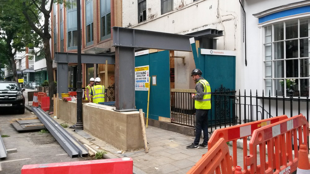 Front of building with steel girders.