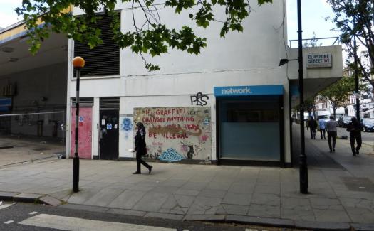 Banksy mural on wall.