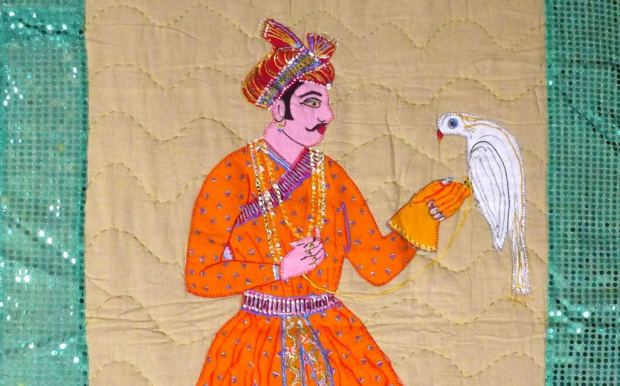 Embroidered artwork illustration man holding a bird on glove.