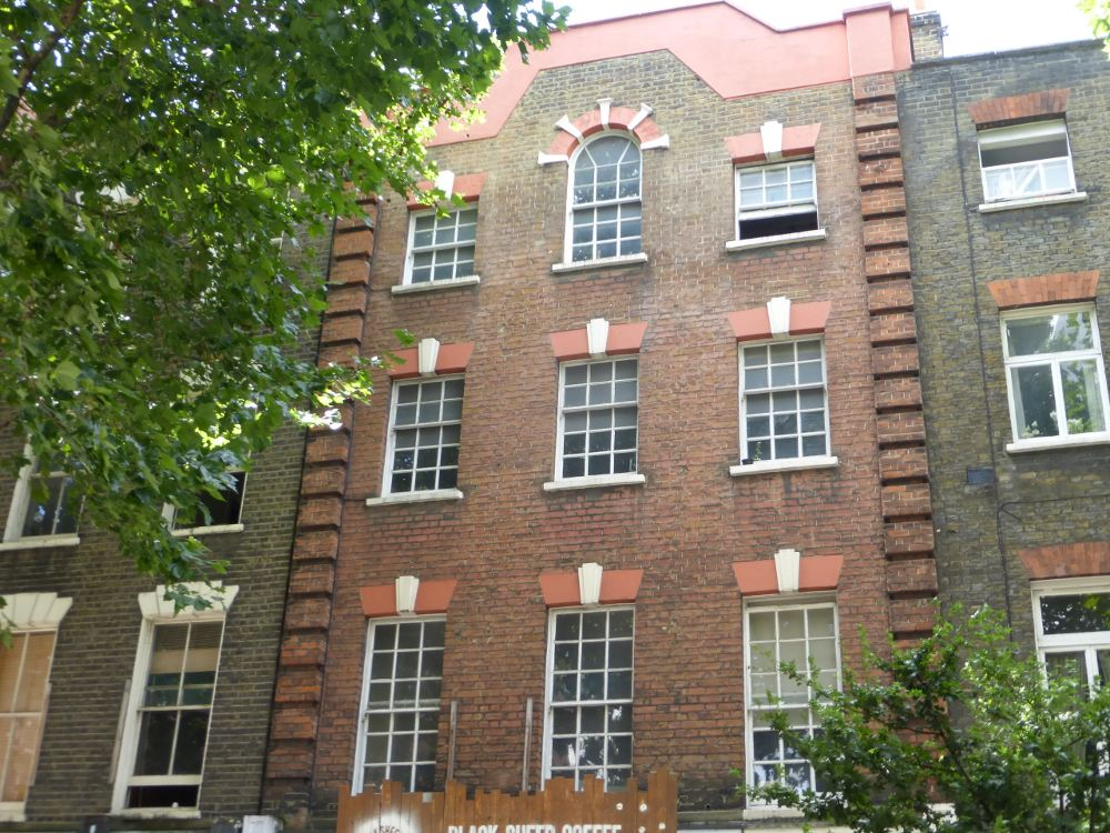 Front of building with sash windows.