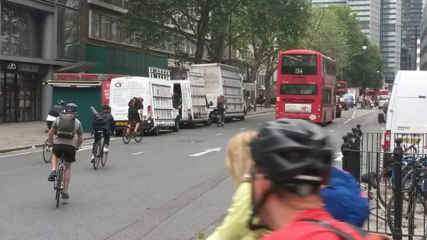 Three vans in cycle lane.