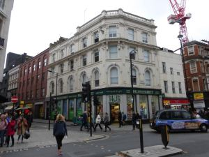 Building on corner of Rathbone Place and Oxford Street.