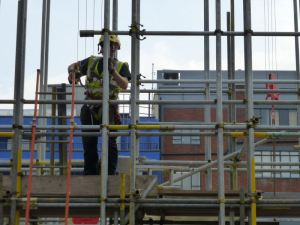 Scaffolding worker on site.