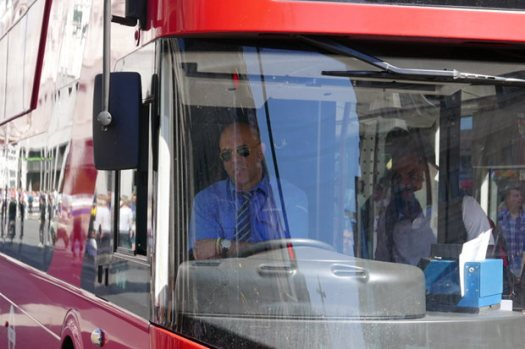 Bus driver sitting in cab.