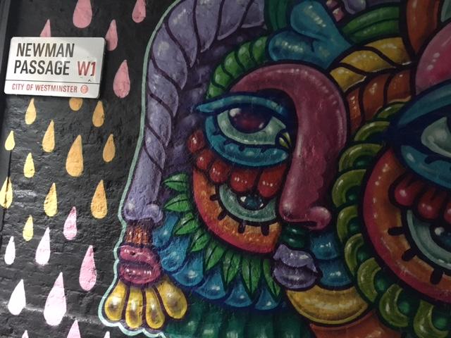 Mural on wall in alleyway.