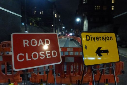 Road closed and diversion signs.