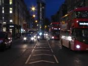 Motor traffic on Tottenham Court Road at night.