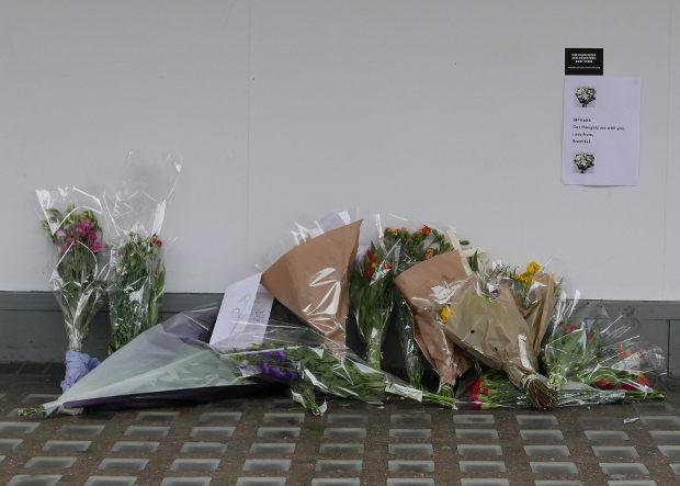 Flowers left on pavement.