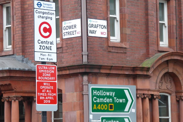 Road signs on street corner.