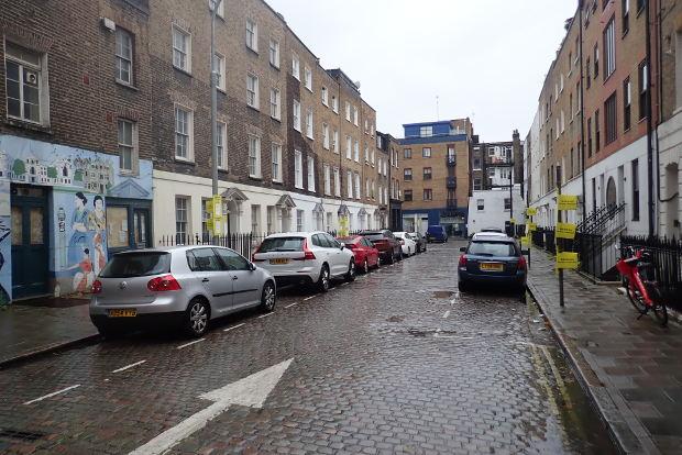 Cobbled street in rain.