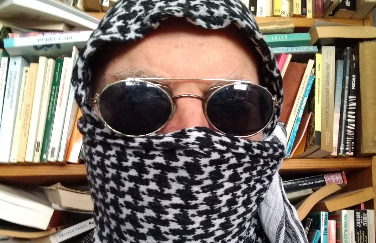 Man wearing a keffiyeh.