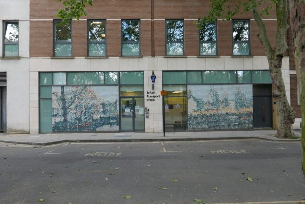 Mosaic panels on front of building.